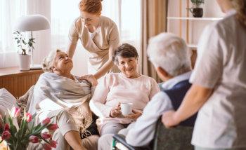 senior woman talking with caregiver