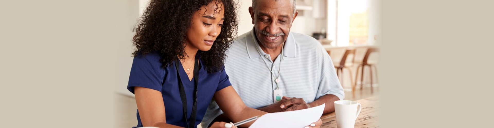Female healthcare worker checking test results with a senior men during a home health visit